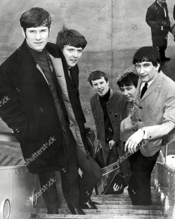"The Animals, rock band from Newcastle, board an airliner at London Airport, bound for New York, where they will appear on ""The Ed Sullivan Show"". From left are Hilton Valentine; Chas Chandler; John Steel; singer Eric Burdon; and new member of the group, organist Dave Rowberry"