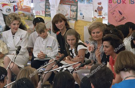 Wives of leaders attending the Economic Summit in Toronto listen as Anna Maria De Mita, right, Italy, talks about books during a storytelling session with Canadian schoolchildren on in Toronto. The wives are, l-r: Nancy Reagan, United States; Mila Mulroney, Canada; and Hannelore Kohl, West Germany