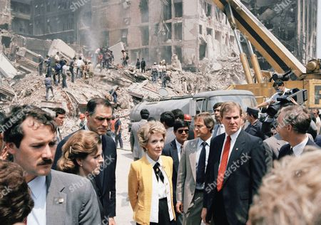 """First Lady Nancy Reagan views earthquake damage tour of Mexico City . While in Mexico City, Mrs. Reagan delivered a letter of sympathy from her husband and a $1 million """"down payment"""" on U.S. government disaster aid to Mexico. At left is Ambassador John Gavin and Mrs. Miguel del la Madrid, wife of Mexico's president"""