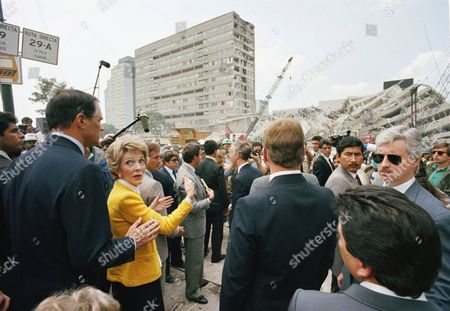 Nancy Reagan gestures as she tours damage from two devastating earthquakes in Mexico City, . Mrs. Reagan is talking to U.S. Ambassador to Mexico John Gavin, left