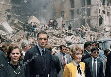 First lady Nancy Reagan and U.S. Ambassador to Mexico John Gavin, left, view earthquake damage in Mexico City . After meeting Mexican President Miguel de la Madrid at his residence, Mrs. Reagan toured streets littered with rubble and smashed cars and met survivors at refugee centers and a Red Cross hospital