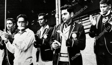 Kumar Shri Indrajitsinhji; Syed Abid Ali; Ramesh Saxena; Farokh Engineer; Umesh Kulkarni India cricket team members from left to right: Kumar Shri Indrajitsinhji, Syed Abid Ali, Ramesh Saxena, Farokh Engineer and Umesh Kulkarni, applaud as they defeat New Zealand in the first test by five wickets on at Carisbrook in Dunedin, New Zealand