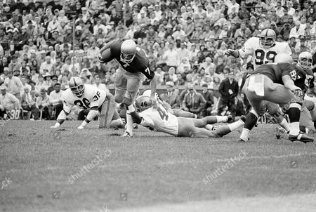 Stock Picture of Cooper Handy Theismann Quarterback Joe Theismann sets up the first field goal for Notre Dame as he drives to the two-yard line in South Bend, Ind., . Defending for Purdue are John Handy (36) and Randy Cooper (46