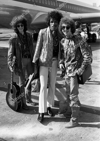Shows Noel Redding, left, Jimi Hendrix, center, and Mitch Mitchell, of the Jimi Hendrix Experience, at Heathrow airport in London. Authorities say Mitch Mitchell, drummer for the legendary Jimi Hendrix Experience of the 1960s, has been found dead in his Portland, Ore. hotel room