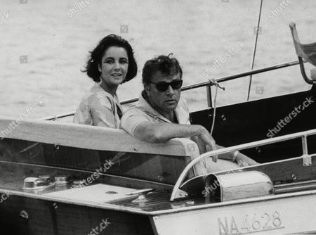 "Richard Burton and Elizabeth Taylor arrive in a motor launch at the small town Porto d'Ischia, on the isle of Ischia in the Gulf of Naples, Italy for the shooting of some scenes of ""Cleopatra"". Publicist Sally Morrison says Taylor died in Los Angeles of congestive heart failure at age 79"