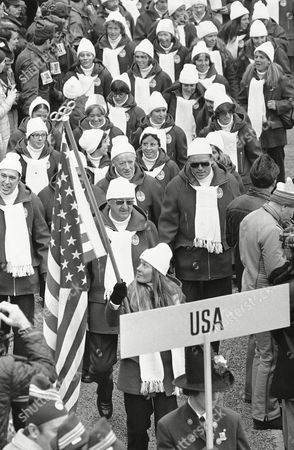 Cindy Nelson Alpine skier Cindy Nelson, of Lutsen, Mn., is the flag-bearer for the United States team marching inside the Bergisel stadium in the opening ceremony of the 12th Winter Olympic Games on in Innsbruck