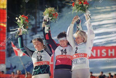 Vreni Schneider, Mateja Svet,Christa Kinshofer-Guetlein Olympic slalom winner Vreni Schneider is framed by her runner-ups Mateja Svet from Yugoslavia, left, and West German Christa Kinshofer-Guetlein during the winning ceremony in the finish at Mt. Allan on