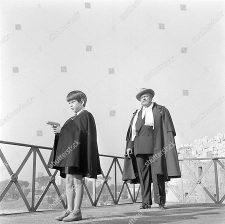 "Orson Welles, Barnaby Shaw Orson Welles, American actor-producer, writer, stars with eight-year-old Barnaby Shaw during filming in Rome, Italy, of an upcoming suspense film ""House of Cards"