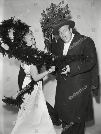 """Orson Welles, Betty Grable Orson Welles takes a backstage beating from Betty Grable as the two rehearse for """"Twentieth Century,"""" a comedy which will be presented on CBS-TV's """"Ford Star Jubilee"""" program, on"""