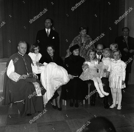 Otto Von Habsburg, Bruno Wechner, Princess Gabriela, Princess Adelhaid, Archduke Robert, Empress Zita, Duchess Clara Posing after Christening of Karl Von Habsburg, heir to the throne of the former Austro-Hungarian empire in Poecking, Germany, from left to right are Bishop Dr. Bruno Wechner, of Feldkirch, Austria; Princess Gabriela; the boy's godmother Princess Adelhaid; behind her, her husband and the boys god-father Archduke Robert; Zita, former Austrian Empress; Standing behind her is Duchess Clara Von Sachsen-Meiningen and the boy's father Otto Von Habsburg with four of his children Michaele, Walburga, Andrea and Monika. The fiths child, Gabriela, is at left