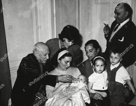 Pablo Picasso Pablo Picasso, world renowned painter, holds bottle for Paola Dominguin after baby was christened in Cannes, France on . Infant is daughter of Spanish bull-fighter Luis Miguel Dominguin and his actress wife, Lucia Bose. Holding child is Mrs. Jacqueline Roques, a friend of Picasso. Picasso, generally regarded as a member of the Communist party, said he acted as godfather to child at a Roman Catholic Church Baptismal ceremony