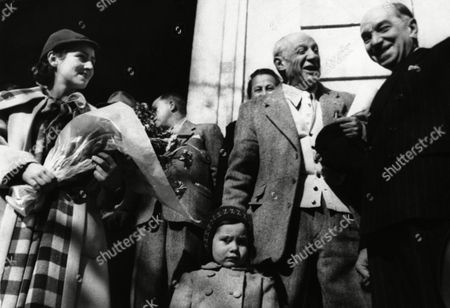 Pablo Picasso Painter Pablo Picasso, second from right, laughs with Virgile Barel, Deputy of the Alpes Maritimes Department, right, on leaving the Town Hall of Vallauris on after a ceremony in which he was made an honorary citizen of the town. His partner Francoise Gilot, left, holds flowers as their son, Claude, looks serious in the foreground