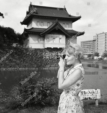 Singer Patti Page takes a last look at the Orient as she shoots some pictures while on a sightseeing tour of the Imperial Palace in Tokyo, . The vocalist will be back on several shows this fall and winter. She recently completed a highly successful singing tour in the Philippines