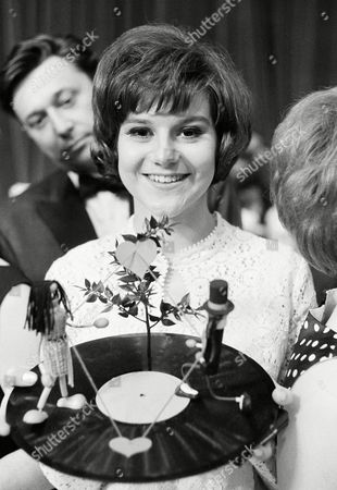 "Peggy March, 17, of Lansdale, PA., holds record with symbols interpreting her song, ""You Still Dream at 17"", which won her the top place at the 5th German song festival in Baden-Baden, Germany, the evening of . She was chosen winner from the votes of 11 German radio stations"