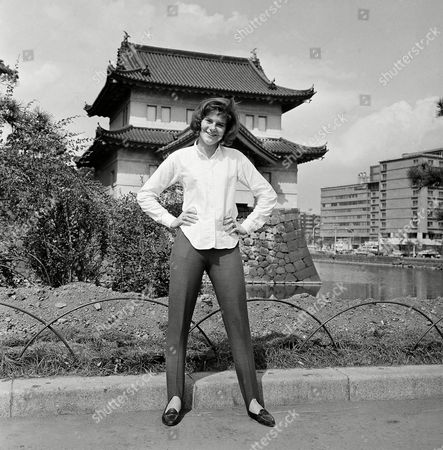 "Peggy March, 16- year-old from the United States is having busy days in Tokyo. Since the arrival in the Japanese capital in August of 1964, she has been tied up with tight performance schedule. Here, former ""little"" Peggy March was pictured in September 1964 during her rare shopping and sightseeing tour in Tokyo between breaks of her performance. Peggy March poses in front of Imperial Palace in Tokyo on"