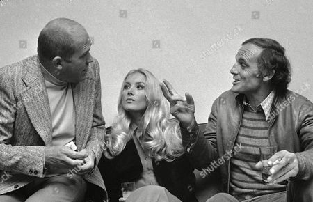 "Philippe Leroy, Castone Moschin, Barbara Bouchet French actor Philippe Leroy gestures as he chats with American actress Barbara Bouchet and Italian actor Castone Moschin during news conference held, to announce the start of shooting of movie ""Milan Caliber 9"" in which they star"