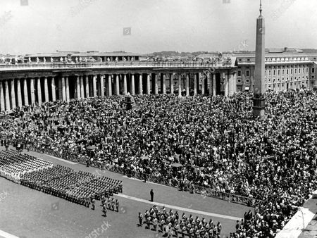 "General view of Saint Peter's Square, packed with people about noon when the Roman Catholic Cardinals, assembled in Conclave, had elected Giovanni Battista Montini, Archbishop of Milan, the successor of Pope John XXIII, under the name of Pope Paul VI. In foreground are lined up detachments of the Italian armed forces. All are waiting for the new Pope to appear on the central balcony of Saint Peter's Basilica, to impart his first blessing ""Urbi et Orbi"" (Over the City of Rome and over the World"