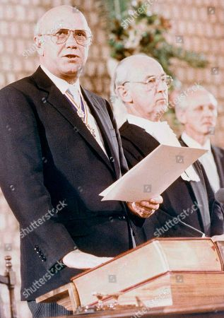 F. W. de Klerk, Michael Corbett F.W. de Klerk places his hand on the bible during the ceremony which has made him State President of South Africa for a five year term, in a Pretoria Church, . The swearing in ceremony, which was administered by Justice Michael Corbett (next to De Klerk) was attended by 1,500 people