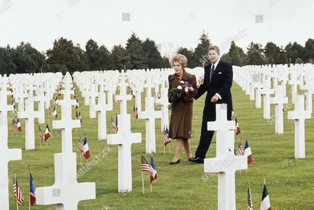Ronald Reagan, Nancy Reagan President Ronald Reagan and his wife Nancy walk through the graves at Normandy American Cemetery in Omaha Beach, France on as they arrived to attend the 40th anniversary of the allied invasion 1944. In foreground is the grave of Theodore Roosevelt Jr., who died in the Normandy 1944
