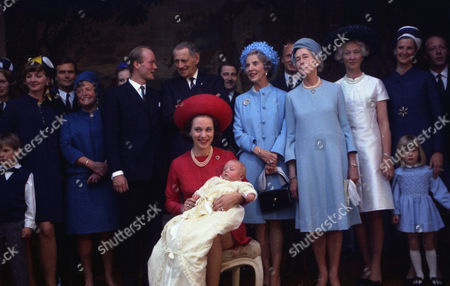 Princess Benedikte and Prince Richard of Sayn-Wittgenstein and their infant son pose with their relativesfor a photo at Castle Berleburg, Bad Berleburg, West Germany, where their offspring was batized today to the names Gustav, Frederik, Philip, Richard, . Woman at left is not identified