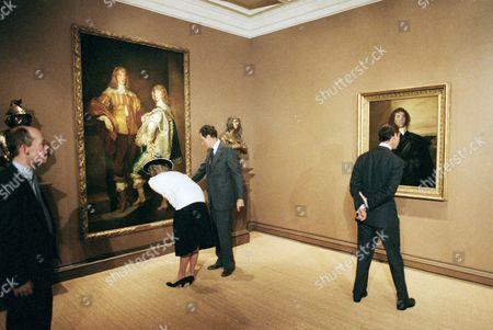 Princess Diana J. Carter Brown and Princess Diana, view a Van Dyke painting of the Stuart brothers as Prince Charles Eyes a Van Dyke of Sir Thomas Hammer of Jacobean gallery on