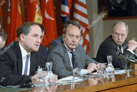 British Defense Secretary George Younger, NATO Secretary General Manfred Woerner and U.S. Secretary of Defense Dick Cheney during press conference ending a two day meeting the Alliance's head office in Brussels on