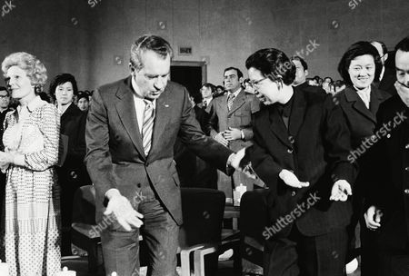 """It's """"after you"""" as former President Richard M. Nixon and Chiang Ching, wife of Chairman Mao Tse-tung of Chinese Communist party, show the way following a reception at Great Hall of the People auditorium on in Beijing. Patricia Nixon is at left"""