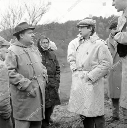 """Roberto Rossellini Italian movie director Roberto Rossellini, left, talks with his son Renzo (generally called Roberto), by his Italian wife Marcello, born de Marchis, at the small village Ceri, about 55 kilometers (35 miles) north of Rome as a new film was started there, directed by Roberto Rossellini and with Renzo as assistant director. Person in center is not identified. The new picture, which is called """"Era Notte a Roma"""" (It was Night in Rome) deals about allied soldiers in Rome during World War 2. British actor Leo Genn, American and Italian actress Giovanna Ralli have the main parts in the film"""