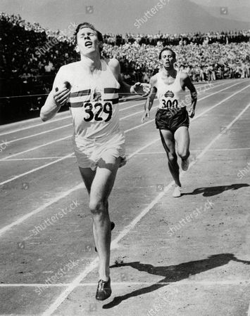 LANDY In the first mile race in history in which two runners finished under four minutes, England's, Dr. Roger Bannister leads John Landy of Australia across the finish line at the British Empire Games in Vancouver, BC. on . Bannister was clocked at 3:58.8, Landy, 3:59.6