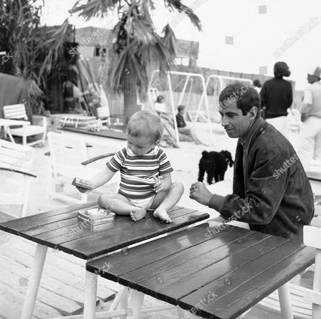One time husband of both Brigitte Bardot and Annette Stroyberg, film director Roger Vadim, playing on the Tahiti beach at St. Tropez, French Riviera, on with his son Christian. Christian's mother is actress Catherine Deneuve
