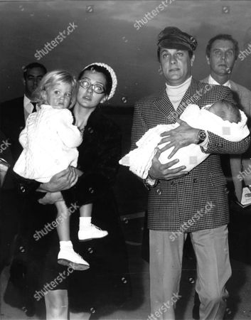 Tony Curtis with his wife Christine Kaufmann and two daughters, Alessandra in mothers arms, and Allegra in fathers arms, on arrival at Rome airport on