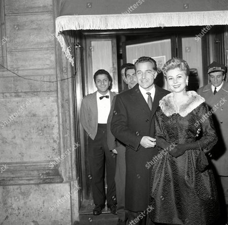 Italian screen actor Rossano Brazzi escorts American screen actress Mitzi Gaynor from a night-club in Rome on after they had celebrated their meeting again in Rome. They have worked together on several films made in the United States