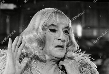 """Sanders Underneath the wig and make up is actor George Sanders on the set of """"The Kremlin Letter,"""" in Rome, . Sanders plays the role of a night club performer who doubles as a master secret intelligence agent in this thriller"""