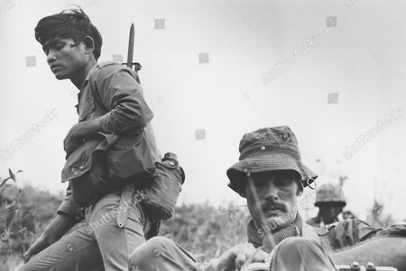 Sean Flynn, American freelance photojournalist covering the war in South East Asia for Time Magazine, is seen in this 1968 picture during operations near Ha Thanh, some 325 miles from Saigon, in South Vietnam. On the left is a Montagnard mercenary, a native hill tribesman fighting in alliance with the U.S. Special Forces. Flynn and the photographer of this picture, Dana Stone, went missing, in the Svay Rieng province of Eastern Cambodia, reportedly being captured by Viet Cong forces based in Cambodia