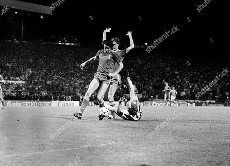 Scene of European Champions Soccer Cup between FC Liverpool and Juventus Turin from the second half, . This scene and this foul on Juventus player Zbigniew Boniek (on ground) later led to the penalty. Liverpool players are Alan Hansen, left, and Jim Beglin, with raised arms