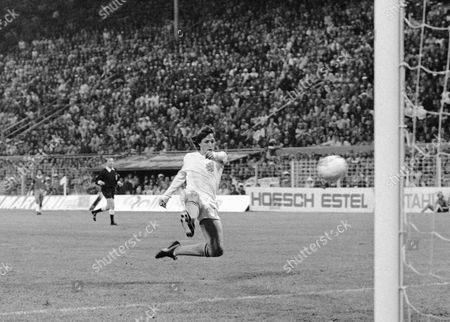 Dutch forward Johann Cruyff scores his team's second goal against Brazil in their World Cup Soccer match, in Dortmund, West Germany. On this day: The Netherlands beats Brazil 2-0 to qualify for the World Cup final