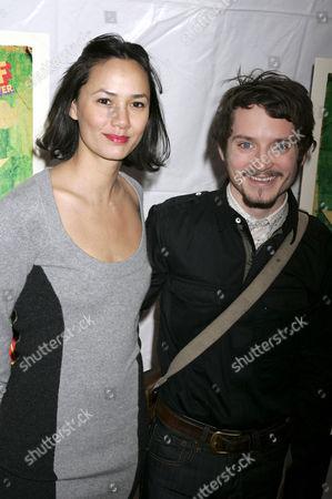 Pamela Racine and Elijah Wood