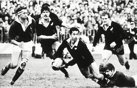 TEST Steve Pokere of New Zealand, centre, passes the ball after being tackled by South Africa's Burger Geldenhuys, during the thurd International Rugby Test Match, played at Eden Park, Auckland, on . From left to right; South Africa Rob Louw, All Blacks Murray Mexted, Pokere and Doug Rollerson. New Zealand defeated South Africa 25-22