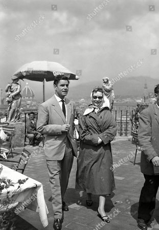 French actress Odile Versois and British actor Anthony Steel walk during a recess of the filming of ?Checkpoint? on the Piazzale Michelangelo overlooking Florence, Italy, . Odile Versois is the older sister of French movie star Marina Vlady