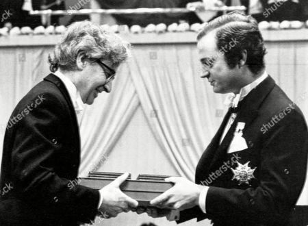 Stock Image of The British winner of the 1974 Nobel Prize for Physics, Antony Hewish, receives his Nobel award from King Carl Gustaf in the Concert Hall in Stockholm, Sweden on