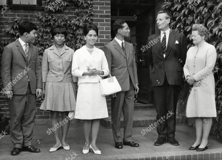 Crown Prince Vajiralongkorn, Princess Ubol Ratana, Queen Sirikit, King Bhumibol, E.P.G. Barrett King and Queen of Thailand collected their son, Crown Prince Vajiralongkorn from the King's Mead Preparatory School in Seaford, Essex, who was ending his terem at the school. Pictured here, left to right, are: Crown Prince Vajiralongkorn; Princess Ubol Ratana, his sister; Queen Sirikit; King Bhumibol; Mr. E.P.G. Barrett, M.A. the school's Headmaster; and his wife, during the visit in