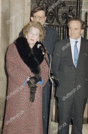 Britain?s Prime Minister Margaret Thatcher, left, is watched by her campaign manager, George Younger, right, as she talks to the press outside No. 10 Downing Street in London, after learning that she had won a handsome but less than crushing victory against an unprecedented challenge to her leadership of the Conservative Party. She got the votes of 314 of the 374 Tory members of Parliament, while 33 supported challenger Sir Anthony Meyer, 24 abstained, and three didn?t vote