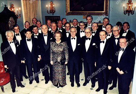 1988 Britain's Prime Minister Margaret Thatcher poses with members of her Cabinet, prior to a dinner in London, England, on Jan.26, 1988, in honour of her becoming the longest-serving British Premier during that century. From left to right front row: Lord Cahncellor The Lord Mackay;Chancellor of the Exchequer Nigel Lawson;former Deputy Prime Minister Lord Whitelaw; Margaret Thatcher; Denis Thatcher; Secretary of State Sir Geoffrey Howe; Defence Secretary George Younger and Minister of Agriculture John macGregor
