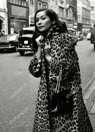 """Eurasian actress Nancy Kwan is seen walking down Bond Street in London, Egland on . Kwan is in London for the premiere of her film """"Fate is the Hunter"""