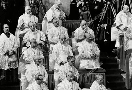 Cardinals of the Roman Catholic Church are pictured in one of the stands in St. Peter's Basilica, Vatican City, during the closing ceremony of the second session of the Ecumenical Council. Left to right from top row: Cardinal Anselmo Albareda; Cardinal Michael Browne. Second row: Alfredo Ottaviani, of the Curia; Leo Joseph Suenens, Archbishop of Brussels; and Raul Silva Henriquez, Archbishop of Santiago de Chile. Bottom row: Rufino Santos, Archbishop of Manila; Bernard Jan Alfrink, Archbishop of Utrecht; and Joseph Lefebvre, Archbishop of Bourges, France