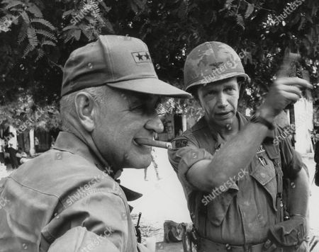 Stock Photo of Creighton W. Abrams, George Patton Jr Gen, Creighton W. Abrams, Commander of U.S forces in Vietnam, chews on his cigar as Col. George Patton, son of the famed world war II General, explains tactics used to secure a village 25 miles North of Saigon, . Patton's 11th armored regiment sealed off the village of Chan Luu while Vietnamese troops flushed out Viet Cong Guerrillas