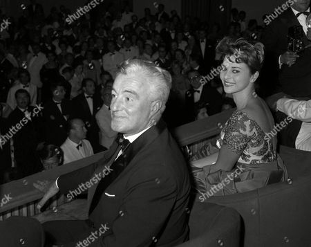 """Vittorio De Sica, Givanna Ralli An international crowd gives Italian actor-director Vittorio De Sica and Italian actress Giovanna Ralli a standing ovation at a Venice Lido cinema, Italy, after the showing of the movie """"Il Generale della Rogere"""" in which De Sica and Miss Ralli star. The film was presented as part of the current international film festival in Venice. It was directed by Italy's Roberto Rossellini"""