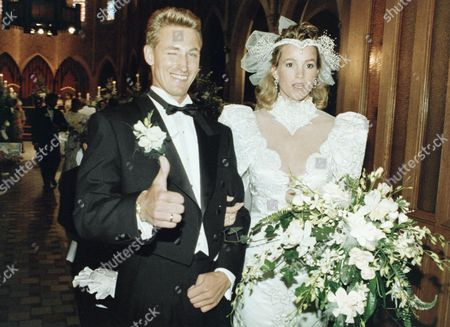 Stock Image of Janet and Wayne Gretzky arrive at the back of St. Joseph's Basilica after being wed before 700 friends and relatives, in afternoon on in Edmonton,Canada. Hockey superstar Gretzky seemed quite nervous throughout the ceremony and then noticeably relieved when it was over