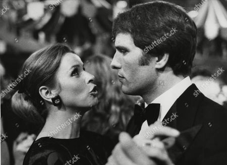 Austrian actress Senta Berger dances with Italian actor Giuliano Gemma at the German Film Ball in Munich, West Germany