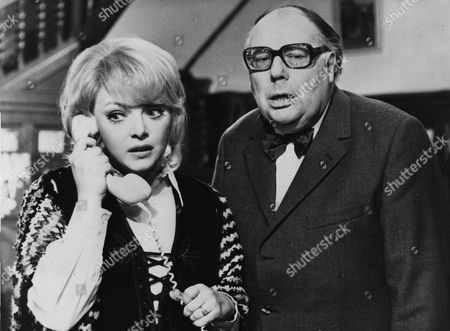 """German comedian, actor Heinz Erhardt, right, is pictured at the set with actress Barbara Schoene on the telephone, during filming the German movie """"Willi wird das Kind schon Schaukeln"""" (Willi will be rocking the child or boat), 1971"""